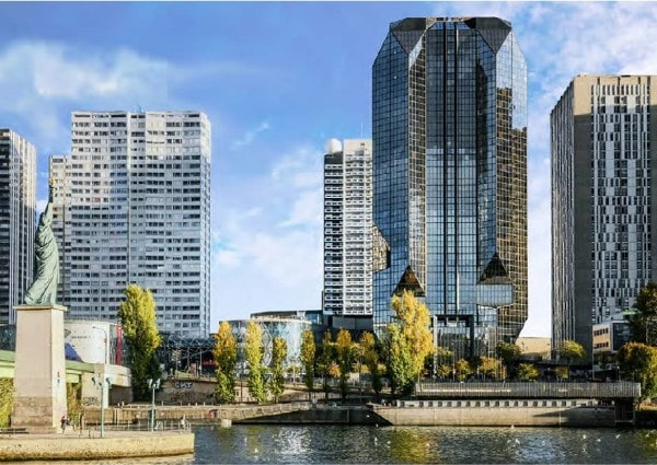 Tishman Speyer, PSP Investments buy office tower in Paris
