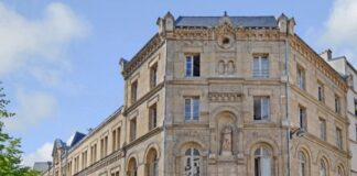 Barings acquires historic office building in Paris